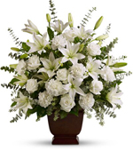 Speak to Shanley's Funeral Home, about their beautiful flower arrangements.